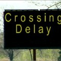 delay crossing sign